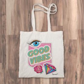 "Bolso de tela ""tote bag"" con accesorios de moda que causan ""buenas vibraciones"""
